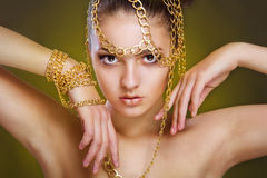 Girl with golden make-up and decoration of gold Royalty Free Stock Photos