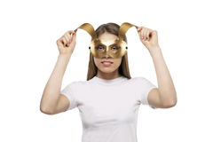 Girl with golden mask Stock Image