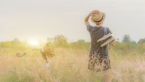 Girl in golden meadow, Canvas shoes. Stock Image