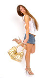 Girl with golden purse. Girl in sunglasses with golden bag on the white background Royalty Free Stock Images