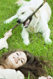 Girl with the golden retriever in the park Royalty Free Stock Photos
