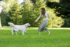 Girl with the golden retriever in the park Royalty Free Stock Photo