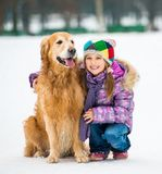 Girl with golden retriever Stock Images