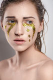 Girl with golden tear Royalty Free Stock Photos