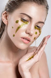Girl with golden tear Stock Images