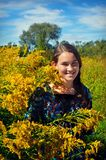 Girl by Goldenrod Royalty Free Stock Photography