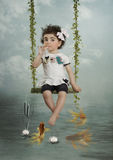 The girl and goldfish Royalty Free Stock Photo