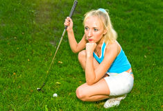 Girl with golf club Royalty Free Stock Photos