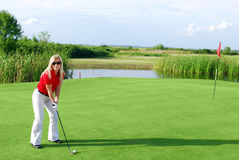 Girl on golf field Royalty Free Stock Photography