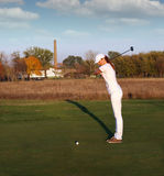 Girl golf player Stock Images
