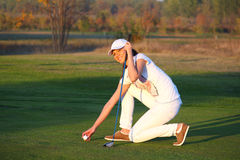 Girl golf player on field Royalty Free Stock Images
