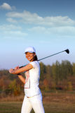 Girl golf player on field Stock Photography