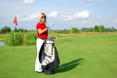 Girl golf player with golf bag Royalty Free Stock Photo