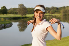 Girl golf player on golf course. royalty free stock images