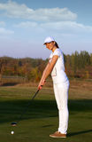 Girl golf player ready for shot Stock Images