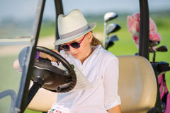 Girl on golf Stock Image