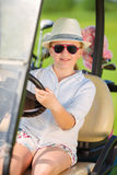 Girl on golf Stock Photo