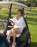 Girl Golfer In Cart Royalty Free Stock Photography