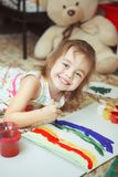 Girl of good mood painting rainbow with brush royalty free stock image