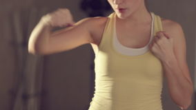 Girl in a good physical shape boxing in the gym stock video