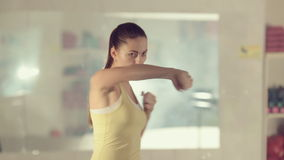 Girl in good physical shape boxing  and making stock video