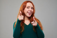 Girl in a good spirit pointing with two fingers stock photos