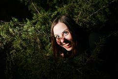 Girl goofing in trees Royalty Free Stock Image