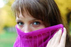 Girl with gorgeous eyes. Behind her purple scarf stock photography
