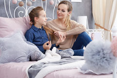 Girl gossiping with mother Royalty Free Stock Photos