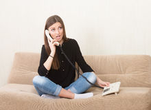 Girl gossiping on phone Royalty Free Stock Image