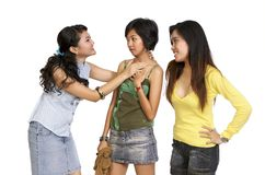 A Girl Got Bully By Her Friends. A Girl Got Bullying and intimidated by her two friends, in the white background Stock Images