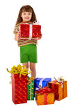 Girl got a lot of gifts for holiday Royalty Free Stock Photography