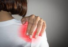 Girl got shoulder pain injury. Woman got shoulder pain injury royalty free stock images