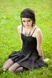 Girl in gothic style on grass Royalty Free Stock Photo