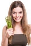 Girl grabbing asparagus Royalty Free Stock Images