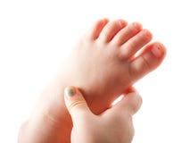 Girl grabbing foot Royalty Free Stock Photo
