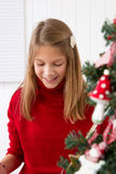 Girl grabs gift on christmas Royalty Free Stock Photo