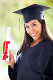 Girl graduating Stock Images