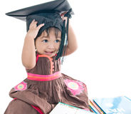 Girl in graduation cap. And books Royalty Free Stock Photo