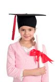 Girl in graduation cap. Holding diploma Royalty Free Stock Photo