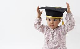 Girl with graduation hat isolated on white Stock Photo