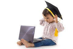 Girl with graduation hat on a laptop isolated Royalty Free Stock Photo