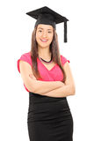 Girl with graduation hat posing Royalty Free Stock Image