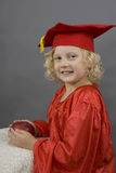 Girl in graduation uniform Stock Photo