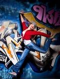 Girl and graffiti Stock Photos