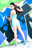 Girl and graffiti Stock Images