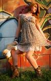 Girl on the graffiti background. Beautiful teenager posing on graffiti background Stock Photos