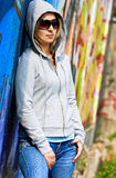 Girl on the graffiti background Royalty Free Stock Photo