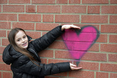 Girl and graffiti heart Royalty Free Stock Image