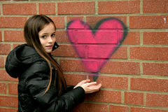 Girl and graffiti heart Royalty Free Stock Images